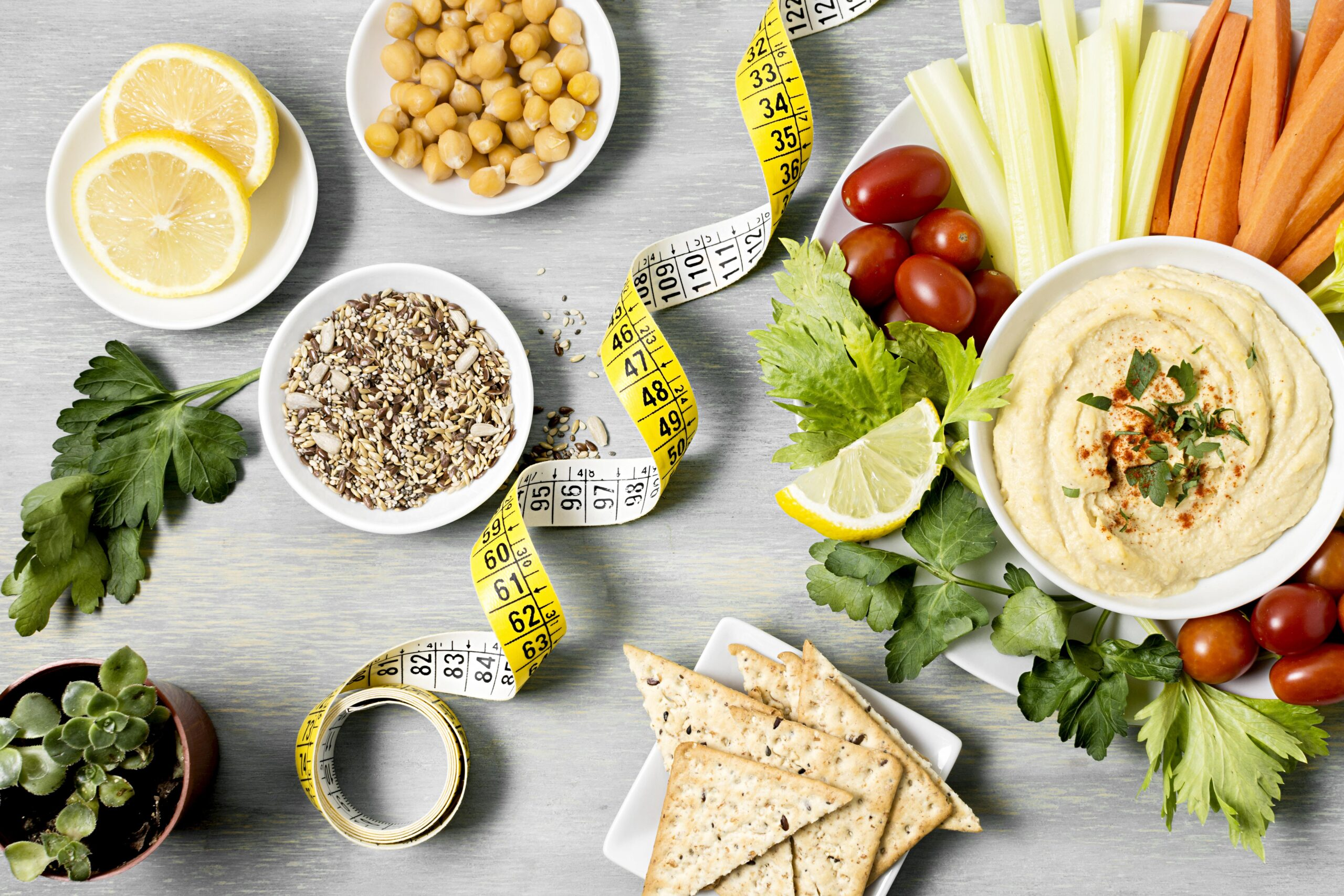 top-view-hummus-with-assortment-vegetables-measuring-tape